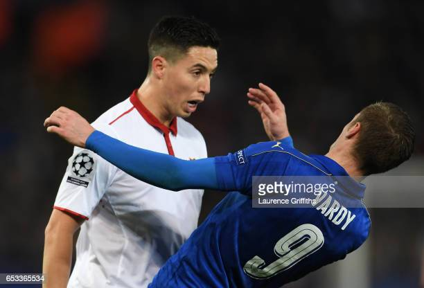 Samir Nasri of Sevilla and Jamie Vardy of Leicester City butt heads during the UEFA Champions League Round of 16 second leg match between Leicester...