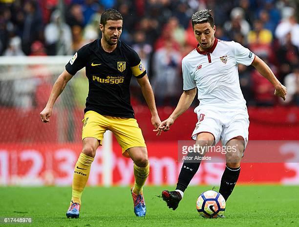 Samir Nasri of Sevilla FC being followed by Gabi Fernandez of Club Atletico de Madrid on during the match between Sevilla FC vs Club Atletico de...