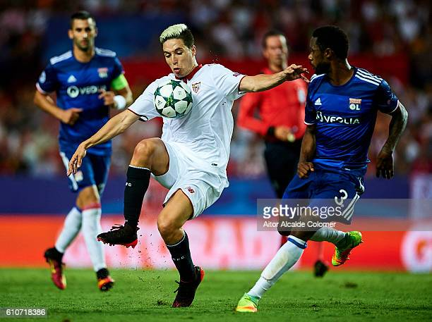 Samir Nasri of Sevilla FC being followed by Nicolas Nkoulou of Olympique Lyonnais during the UEFA Champions League match between Sevilla FC and...