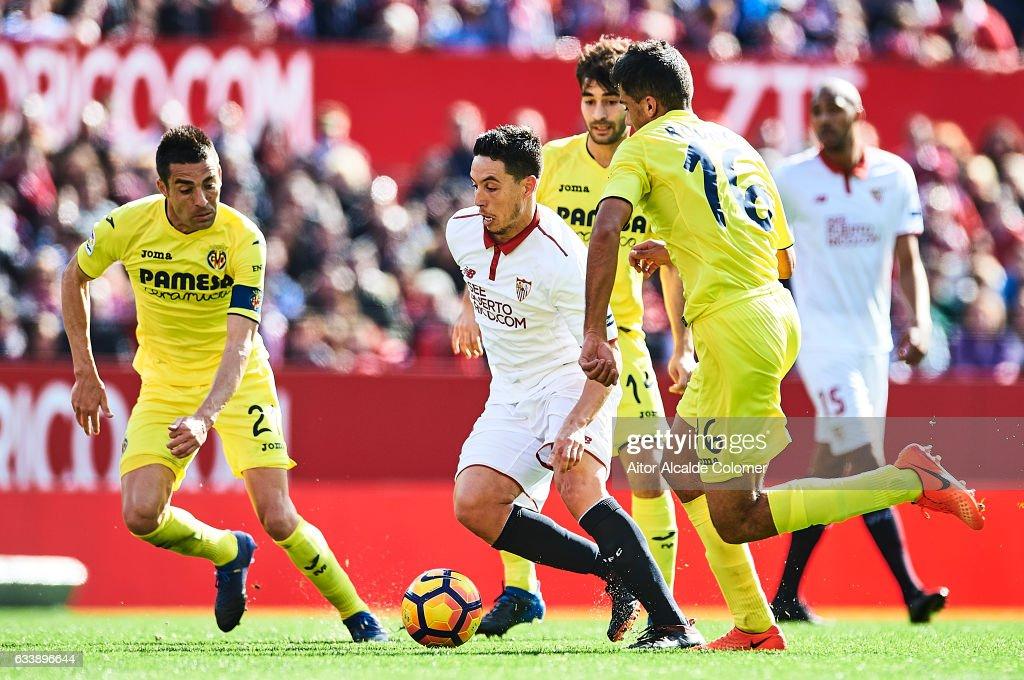 Samir Nasri of Sevilla FC (C) being followed by Rodrigo Hernandez of Villarreal CF (R) and Bruno Soriano of Villarreal CF (L) during the La Liga match between Sevilla FC and Villarreal CF at Estadio Ramon Sanchez Pizjuan on February 05, 2017 in Seville, Spain.