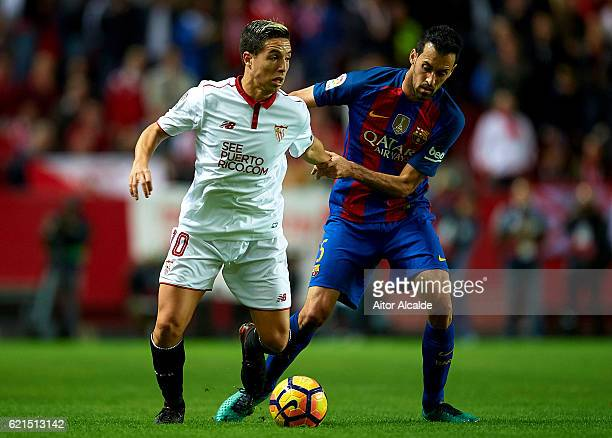 Samir Nasri of Sevilla FC being followed by Sergio Busquets of FC Barcelona during the match between Sevilla FC vs FC Barcelona as part of La Liga at...
