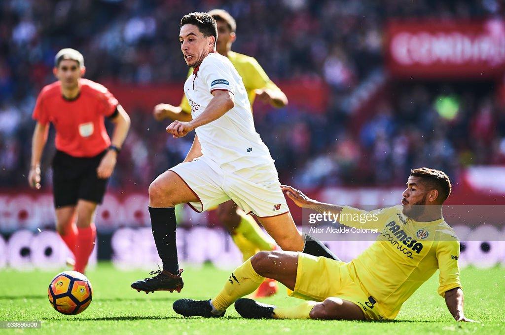 Samir Nasri of Sevilla FC (L) competes for the ball with Jonathan Dos Santos of Villarreal CF (R) during the La Liga match between Sevilla FC and Villarreal CF at Estadio Ramon Sanchez Pizjuan on February 05, 2017 in Seville, Spain.