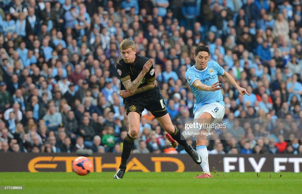 Samir Nasri on Man City scores to make it 2-1 during the FA Cup Quarter-Final match between Manchester City and Wigan Athletic at the Etihad Stadium on March 9, 2014 in Manchester, England.