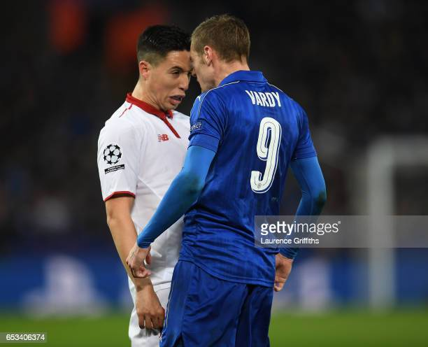 Samir Nzira of Sevilla FC argues with Jamie Vardy of Leicester Cty during the UEFA Champions League Round of 16 second leg match between Leicester...