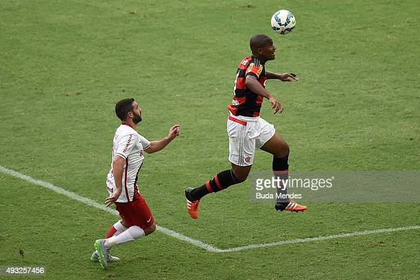 Samir of Flamengo battles for the ball with Lisandro Lopez of Internacional during a match between Flamengo and Internacional as part of Brasileirao...