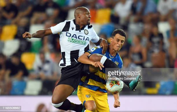Samir of Udinese Calcio competes for the ball with Roberto Inglese of Parma Calcio during the Serie A match between Udinese Calcio and Parma Calcio...