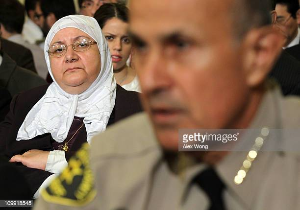 Samira Hussein of Gaithersburg, Maryland, listens as Sheriff Lee Baca of Los Angeles County, California, testifies during a hearing before the House...