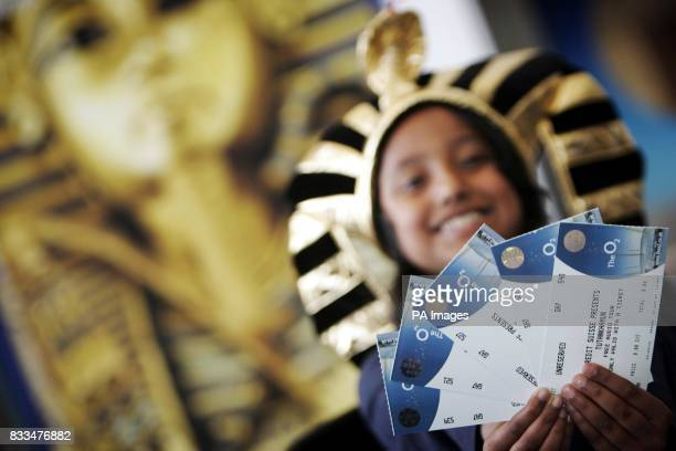 Samirah Rahat from Mayflower Primary School Tower Hamlets London holds out tickets for her class as local school children gathered at The O2 to...