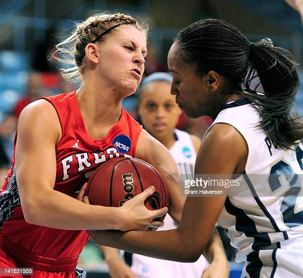 Samisha Powell of the Georgetown Hoyas tussles with Blakley Goldberg of the Fresno State Bulldogs during the second round of the 2012 NCAA Women's...