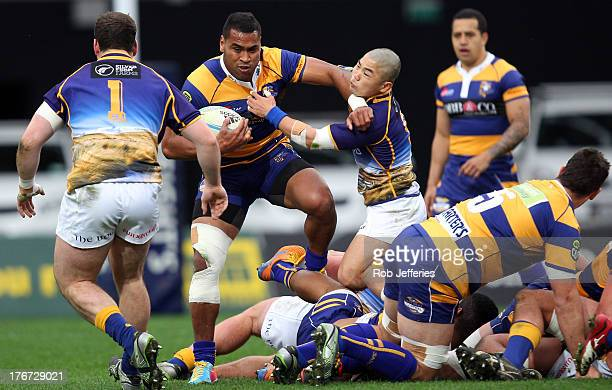 Samisoni Fisilau of Bay of Plenty attempts to bust the attempted tackle of Fumiaki Tanaka during the round one ITM Cup match between Otago and the...
