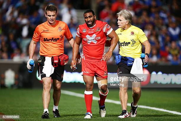 Samisoni Langi of Tonga is assisted from the field after sustaining an injury during the International Rugby League Test match between Tonga and...