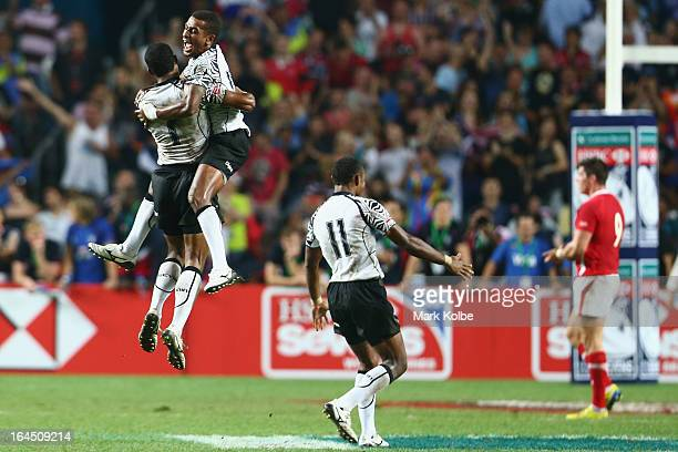 Samisoni Viriviri and Emosi Mulevoro of Fiji celebrate after winning the cup final match between Fiji and Wales during day three of the 2013 Hong...