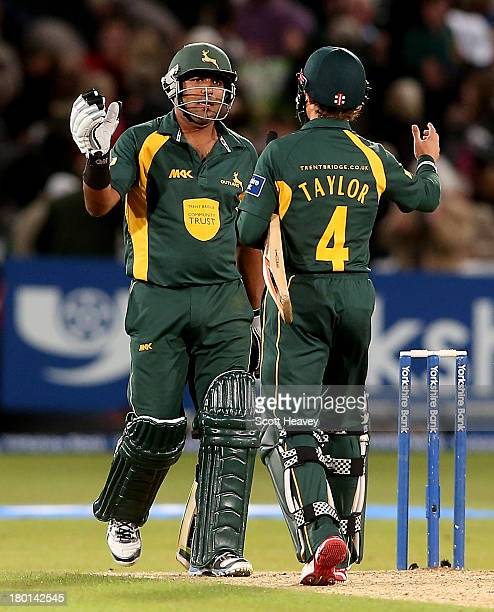 Samit Patel and James Taylor of Nottinghamshire celebrate after their victory during the Yorkshire Bank 40 Semi Final match between Nottinghamshire...