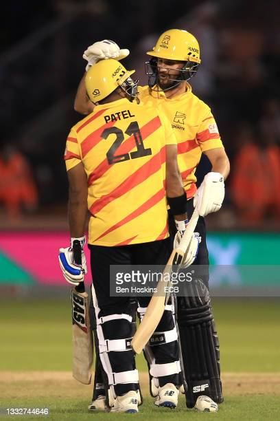 Samit Patel and Lewis Gregory of Trent Rockets celebrate victory during The Hundred match between Welsh Fire Men and Trent Rockets Men at Sophia...