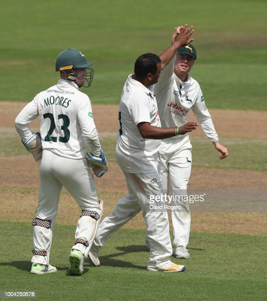 Samit Patel of Nottinghamshire celebrates taking the wicket of Rory Burns during the Specsavers County Championship division one match between...