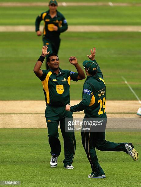 Samit Patel of Nottinghamshire celebrates with David Hussey after bowling David Sales of Northamptonshire during the Yorkshire Bank 40 match between...