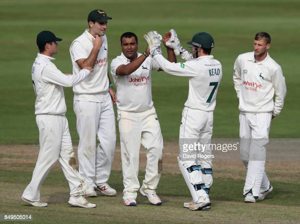 Samit Patel of Nottinghamshire celebrates with team mates after bowling Rory Kleinveldt during the Specsavers County Championship Division Two match...
