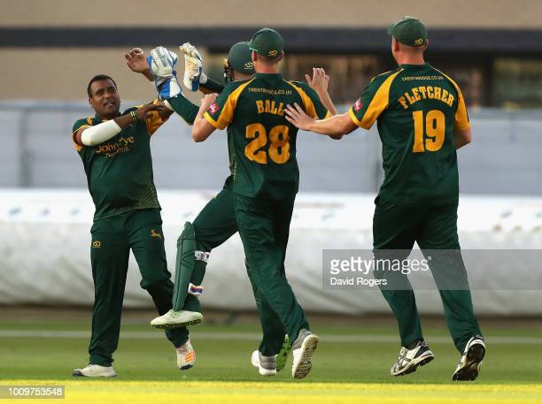 Samit Patel of Nottinghamshire celebrates with team mates after taking the wicket of Calum MacLeod during the Vitality Blast match between...