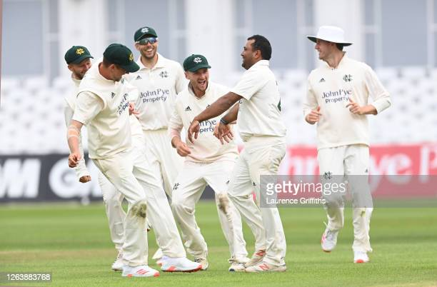 Samit Patel of Nottinghamshire is congratulated on the wicket of Matthew Critchley fo Derbyshire during Day 4 of the Bob Willis Trophy match between...