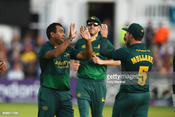 Samit Patel of Nottinghamshire Outlaws celebrates with Steven Mullaney of Nottinghamshire Outlaws after taking the wicket of Michael Leask of...