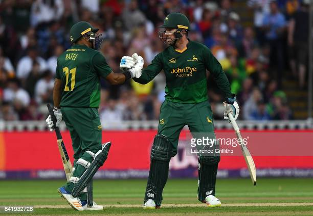 Samit Patel of Notts celebrates with team mate Brendan Taylor after reaching his half century during the NatWest T20 Blast Final between Birmingham...