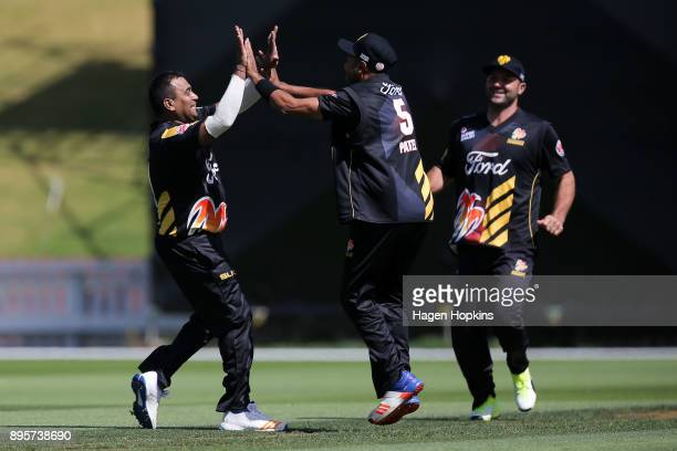 Samit Patel of the Firebirds celebrates with Jeetan Patel after taking the wicket of Anton Devcich of the Knights during the Twenty20 Supersmash...