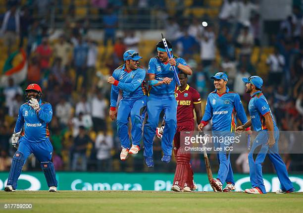 Samiullah Shenwari and Hamid Hassan of Afghanistan celebrate their victory with a bump during the ICC World Twenty20 India 2016 Group 1 match between...