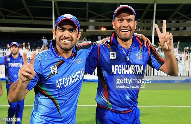 Samiullah Shenwari and Merwais Ashraf of Afghanistan celebrate their teams win after the ICC World Twenty20 Qualifier between Afghanistan and Nepal...