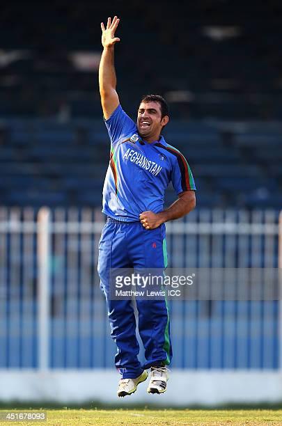 Samiullah Shenwari of Afghanistan celebrates taking his fifth wicket of Irfan Karim of Kenya after he was caught by Merwais Ashraf during the ICC...