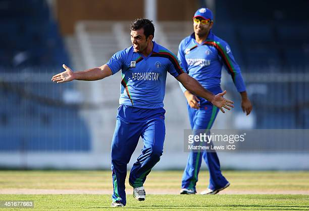 Samiullah Shenwari of Afghanistan celebrates the wicket of Alex Obanda after he was caught by Mohammad Nabi during the ICC World Twenty20 Qualifier...