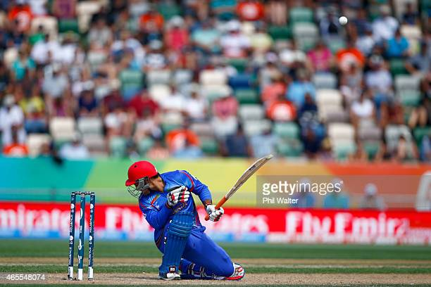 Samiullah Shenwari of Afghanistan is hit by a bouncer during the 2015 ICC Cricket World Cup match between New Zealand and Afghanistan at McLean Park...