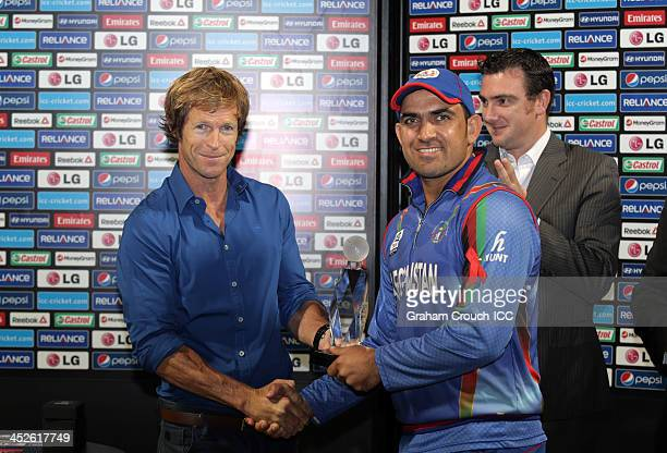 Samiullah Shenwari of Afghanistan was awarded Player of the Tournament by Jonty Rhodes following the Ireland v Afghanistan Final won by Ireland at...