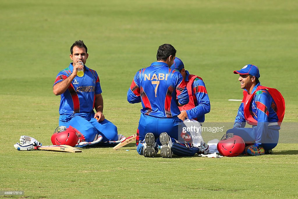 Samiullah Shinwari and Mohammad Nabi of Afghanistan sit for a drinks break during the One Day tour match between the Western Australia XI and Afghanistan at the WACA on September 22, 2014 in Perth, Australia.