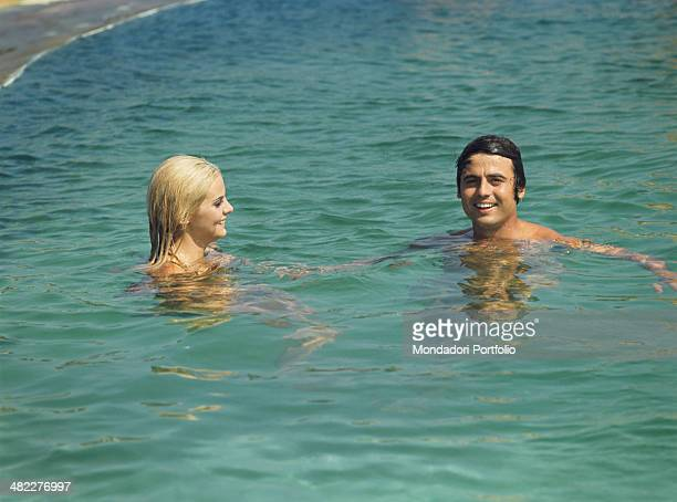 Sammarinese singer Little Tony swimming with Italian actress and model Silvia Dionisio Porto Cervo 1968