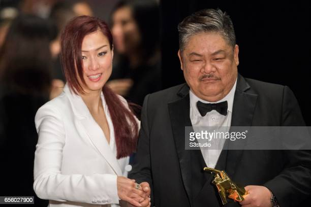Sammi Cheng Sau-man, recipient of the Excellence in Asian Cinema Award, and Lam Suet, winner of the Best Supporting Actor award for 'Trivisa', pose...