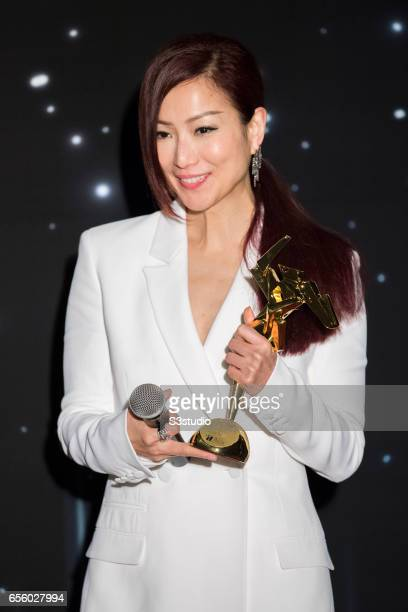 Sammi Cheng Sau-man, recipient of the Excellence in Asian Cinema Award, poses with the award during the 11th Asian Film Awards on March 21, 2017 at...