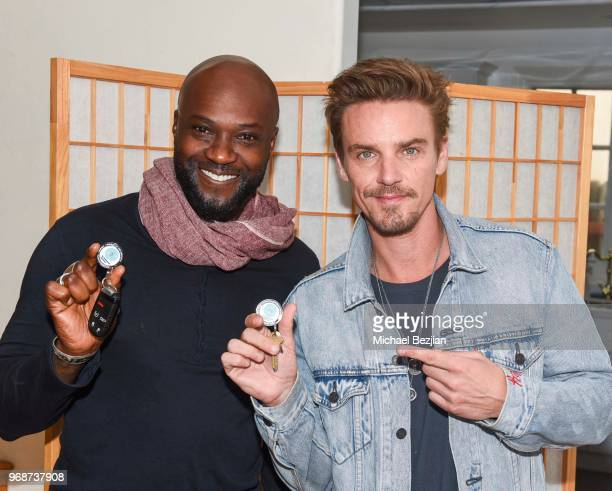 Sammi Rotibi and Riley Smith pose with TAP Medallion at Giveback Day at TAP The Artists Project on June 6 2018 in Los Angeles California