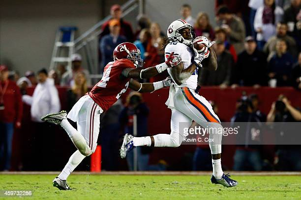 Sammie Coates of the Auburn Tigers catches a 53 yard pass thrown by Nick Marshall in the fourth quarter against Geno Smith of the Alabama Crimson...