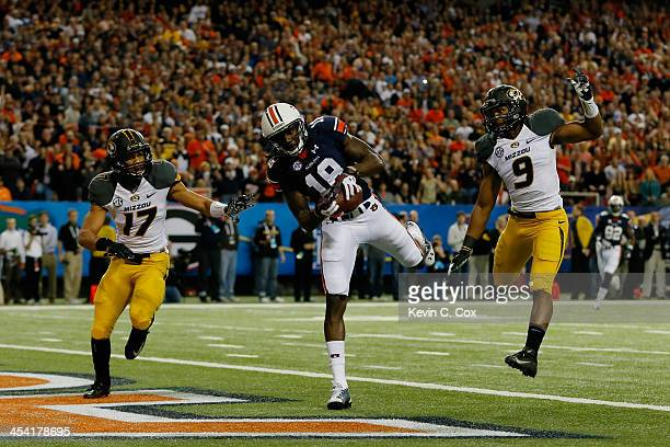 Sammie Coates of the Auburn Tigers scores a touchdown against Matt White and Braylon Webb of the Missouri Tigers in the first quarter during the SEC...