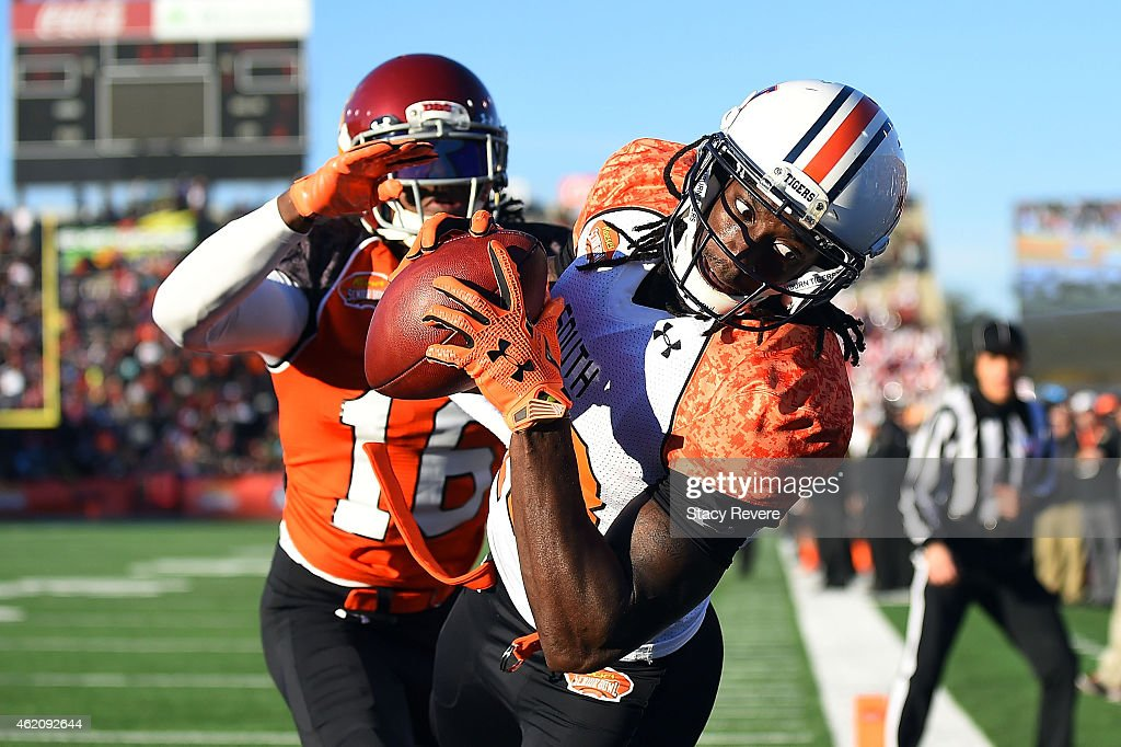 Sammie Coates #18 of the South team catches a pass in front of Josh Shaw #16 of the North team during the second quarter of the Reese's Senior Bowl at Ladd Peebles stadium on January 24, 2015 in Mobile, Alabama.
