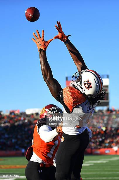 Sammie Coates of the South team catches a pass in front of Josh Shaw of the North team during the Reese's Senior Bowl at Ladd Peebles Stadium on...