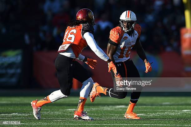 Sammie Coates of the South team works against Josh Shaw of the North team during the Reese's Senior Bowl at Ladd Peebles Stadium on January 24 2015...