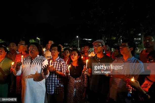 Sammilito Sangskritik Jote members observe a minute's silence at Shaheed Minar for the victims of the Gulshan cafe tragedy in Dhaka on July 3 2016 in...