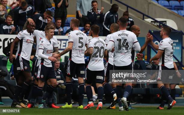 Sammy Ameobi celebrates scoring his side's first goal with teammates during the Sky Bet Championship match between Bolton Wanderers and Sheffield...