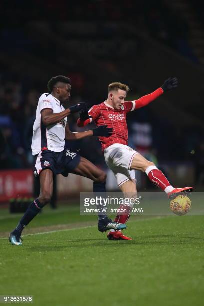 Sammy Ameobi of Bolton Wanderers and Josh Brownhill of Bristol City during the Sky Bet Championship match between Bolton Wanderers and Bristol City...