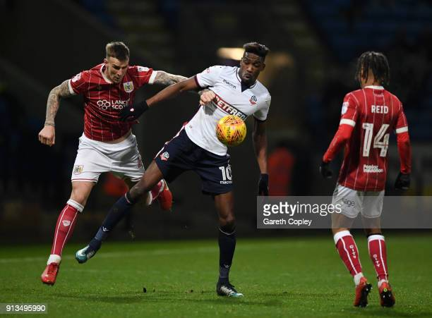 Sammy Ameobi of Bolton Wanderers wins the ball under pressure from Aden Flint of Bristol City during the Sky Bet Championship match between Bolton...