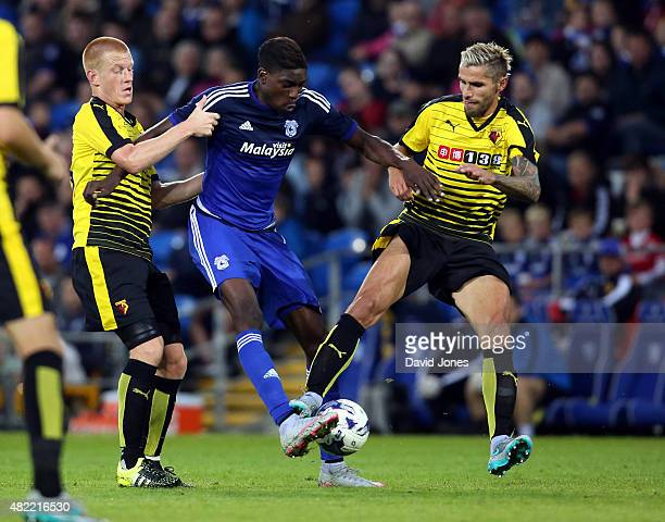 Sammy Ameobi of Cardiff City is tackled by Ben Watson and Valon Behrami of Watford during the pre season friendly match between Cardiff City and...