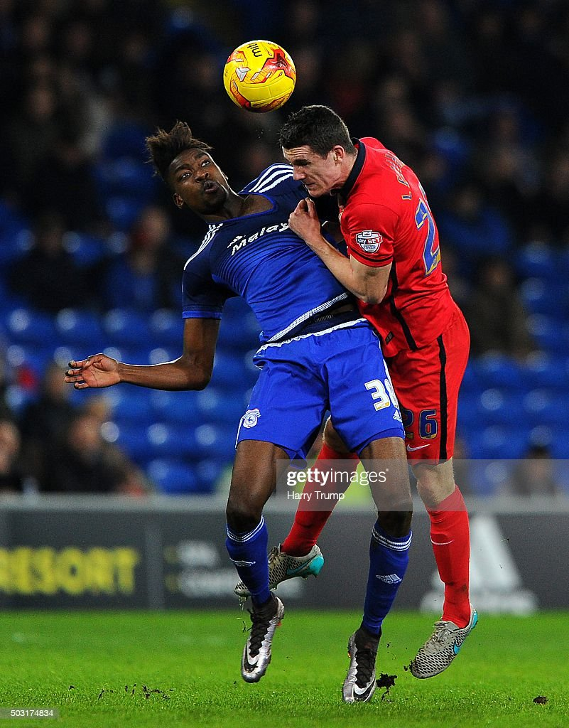 Sammy Ameobi of Cardiff City is tackled by Darragh Lenihan of Blackburn Rovers during the Sky Bet Championship match between Cardiff City and Blackburn Rovers at the Cardiff City Stadium on January 2, 2016 in Cardiff, Wales.