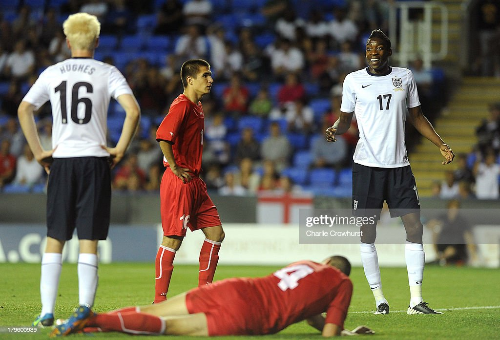 Sammy Ameobi of England (R) reacts after missing an open goal during the 2015 UEFA European U21 Championships Qualifier between England U21 and Moldova U21 at The Madejski Stadium on September 05, 2013 in Reading, England,