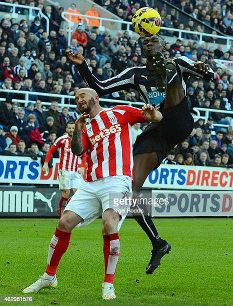 Sammy Ameobi of Newcastle United clears the ball from Stephen Ireland of Stoke City during the Barclays Premier League match between Newcastle United...
